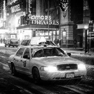 Snowstorm on 42nd Street in Times Square with Yellow Cab by Night by Philippe Hugonnard