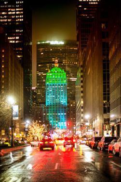 The Metlife Building Towers over Grand Central Terminal at Night by Philippe Hugonnard