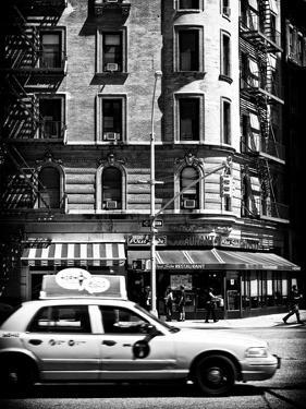Urban Scene with Yellow Cab on the Upper West Side of Manhattan, NYC, Black and White Photography by Philippe Hugonnard