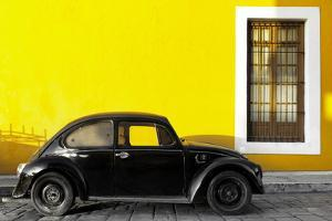 ¡Viva Mexico! Collection - Black VW Beetle Car with Yellow Street Wall by Philippe Hugonnard