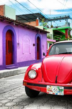 ¡Viva Mexico! Collection - Red VW Beetle Car in a Colorful Street by Philippe Hugonnard