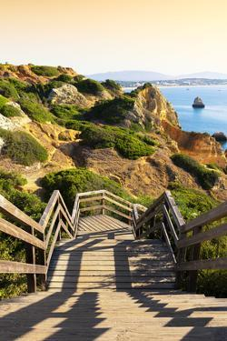Welcome to Portugal Collection - Wooden Staircase to Sandy Praia do Camilo Beach at Sunset by Philippe Hugonnard