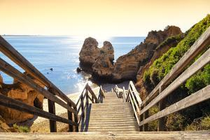 Welcome to Portugal Collection - Wooden Stairs to Praia do Camilo Beach at Sunset by Philippe Hugonnard