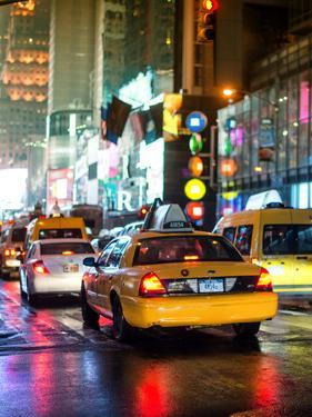 Yellow Cab on 7th Avenue at Times Square by Night by Philippe Hugonnard