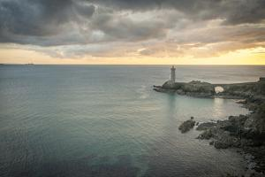 Lighthouse in the bay in Bittany by Philippe Manguin