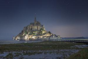 Sweet mood on Mont Saint Michel at night by Philippe Manguin