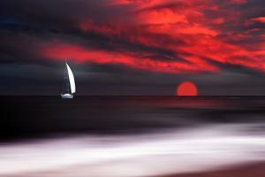 White sailboat and red sunset by Philippe Sainte-Laudy