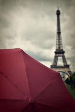 Eiffel Tower and Red Umbrella by Photo by Ira Heuvelman-Dobrolyubova