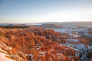 Sun Rising over Bryce Canyon by photo by Kenneth Moore