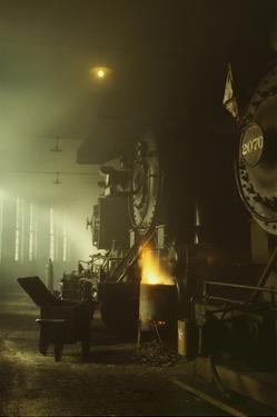 Photo of Fronts of Steam Engine Locomotives on Factory Floor