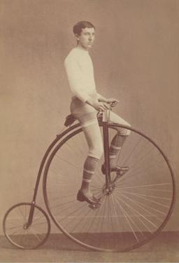 Photo of Man on Vintage Bicycle
