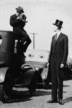Photographer Mounts Himself on Roof of a Car to Shoot a Pictures of Exceedingly Tall Men in Top Hat
