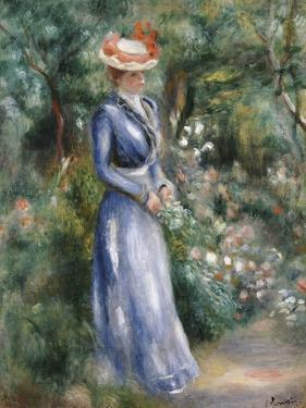 Woman in a Blue Dress Standing in the Garden at Saint-Cloud by Pierre-Auguste Renoir