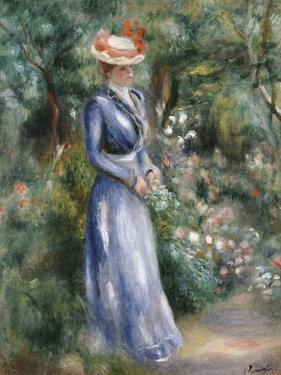Woman in a Blue Dress Standing in the Garden at Saint-Cloud by Pierre-Auguste Renoir