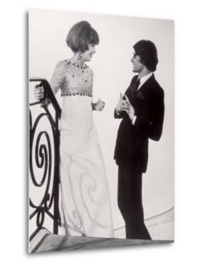 Fashion Designer Yves Saint Laurent Talking with Client Mrs. Stanley Donen at His Boutique by Pierre Boulat