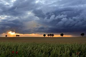 Summer Sunset with Storm Clouds by pierre hanquin photographie