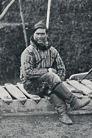 An Eskimo resting on his sledge, 1912