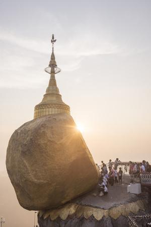 https://imgc.allpostersimages.com/img/posters/pilgrims-at-golden-rock-stupa-kyaiktiyo-pagoda-at-sunset-mon-state-myanmar-burma-asia_u-L-Q12SDZC0.jpg?p=0