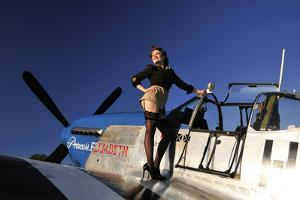 Pin-Up Girl Standing on the Wing of a P-51 Mustang