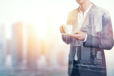 Double Exposure of City and Business Man with Cup of Coffee by pinkypills