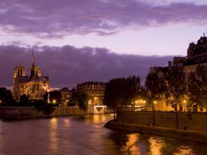 Notre Dame Cathedral and Ile Saint-Louis at Dusk, Paris, France, Europe by Pitamitz Sergio