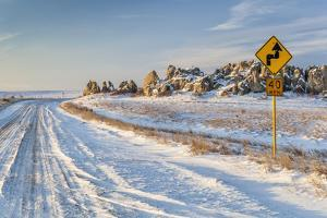 Back Country Road over Prairie at Natural Fort in Northern Colorado in Winter Scenery, a Road Sign by PixelsAway
