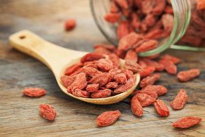 Tibetan Goji Berries (Wolfberry) Spilling of the Glass Jar on a Wooden Spoon, Selective Focus by PixelsAway