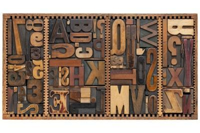 Vintage Letterpress Printing Blocks Abstract With Variety Of Letters, Numbers, Punctuation Signs by PixelsAway
