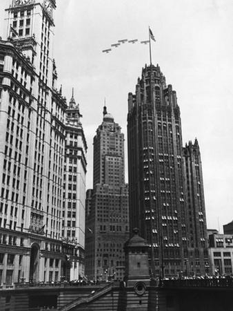Planes Fly over Buildings in Chicago