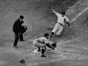 Player Attempting to Slide Home During an Unidentified Baseball Game