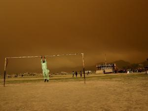 Playing a Friendly Soccer Match in a Park During a Sandstorm in Kabul, Afghanistan