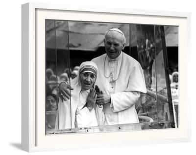 Pope John Paul II Holds His Arm Around Mother Teresa