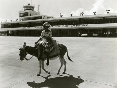 https://imgc.allpostersimages.com/img/posters/port-au-prince-airport-haiti-c-1965_u-L-PPQV940.jpg?p=0