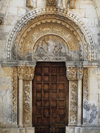 https://imgc.allpostersimages.com/img/posters/portal-of-san-leonardo-abbey-in-lama-volara-manfredonia-apulia-italy-12th-century_u-L-POPTS80.jpg?artPerspective=n
