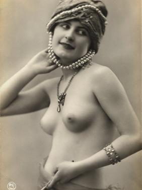 Portrait of a Barebreasted Young Woman, Wearing a Pearl-Decorated Hat