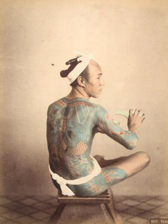 Portrait of a Seated 'Tattoo' Man Tattooing Himself