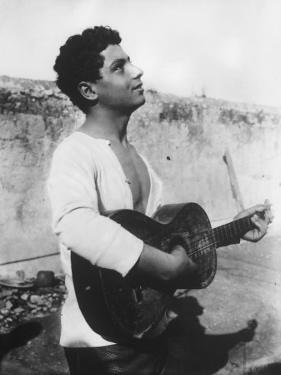 Portrait of a Young Sicilian Man Playing the Guitar