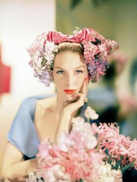 Portrait of Model in Headdress of Pink and Mauve Lilacs in Loose Bunches
