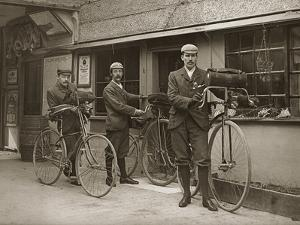 Portrait of Three Young Men with Bicycles Outside a Train Station, Kent, UK, C.1920
