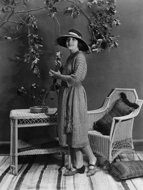 Portrait of Woman Indoors Holding Tennis Racket