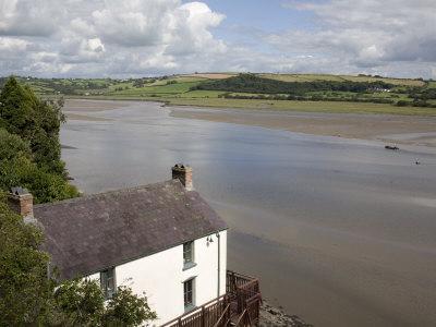 Taf Estuary with Dylan Thomas Boathouse, Laugharne, Carmarthenshire, South Wales, United Kingdom
