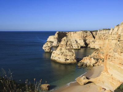 https://imgc.allpostersimages.com/img/posters/praia-da-marinha-algarve-portugal-europe_u-L-P7O0SG0.jpg?p=0
