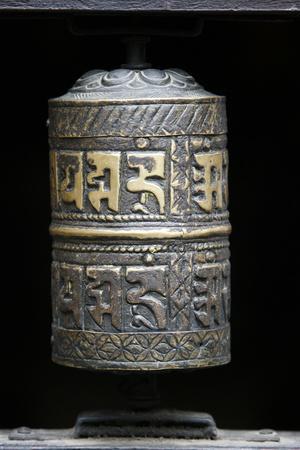 https://imgc.allpostersimages.com/img/posters/prayer-wheel-golden-temple-patan-nepal_u-L-Q1GYIR10.jpg?artPerspective=n