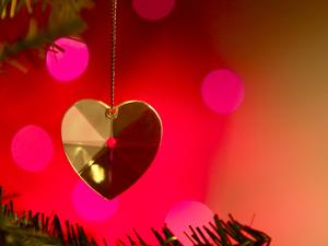 Precious Gold Heart Decoration Dangling from Christmas Tree