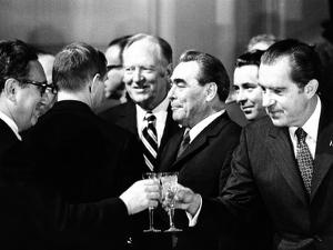 Pres Richard Nixon and Henry Kissinger Clink Champagne Glasses to Toast