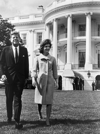 President and Mrs. John F. Kennedy Walking on the South Lawn of the White House on April 16, 1962