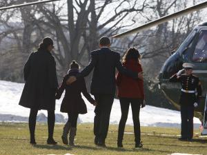 President Barack Obama anf Family Walk on the South Lawn of the White House in Washington