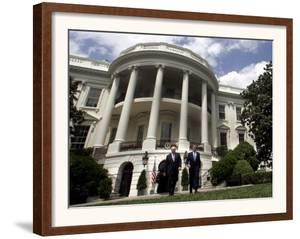President Bush, Right, and Vice President Dick Cheney Walk to the South Lawn