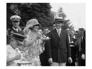 President Calvin Coolidge Smiles Along with His Wife at a White House Garden Party in June 1926