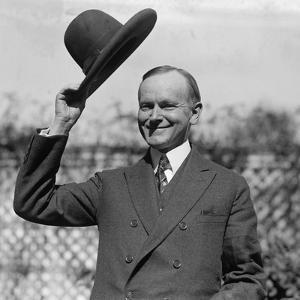 President Calvin Coolidge Waves a Hat Presented to Him by Smoki People of Prescott, Arizona
